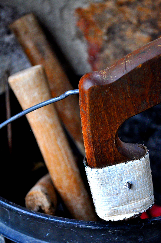 Tools of the Trade: Bucket of Handles, Hacksaw and Hammers by Melanie Faith